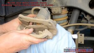 Remove rear brake pads