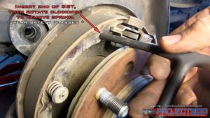 Remove brake shoe return spring landcruiser 200