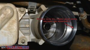 Clean oil filter housing